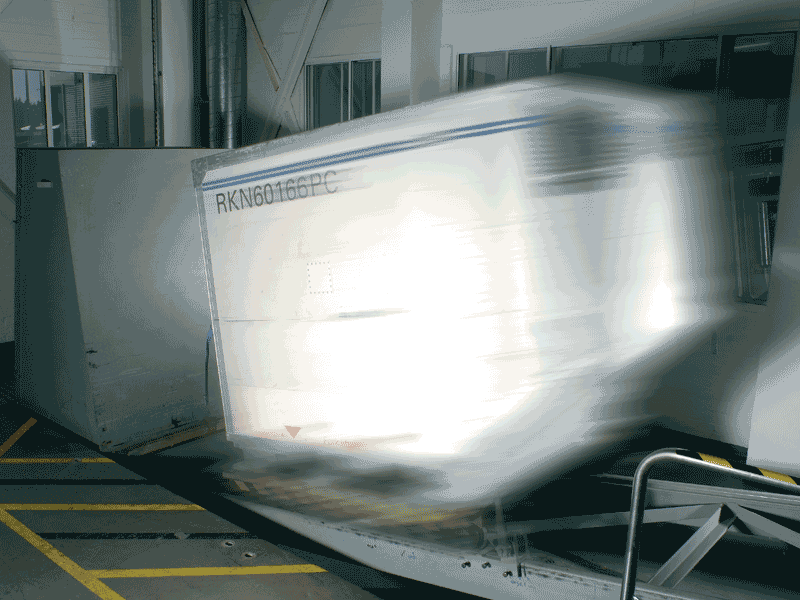 A large package in an impact test being moved at high speed into a wall.