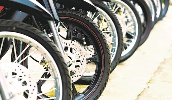 How does the emergence of electric motorcycles create implications for tires?